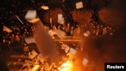 Ukrainian protesters throw out and burn papers from prosecutor's headquarters in Lviv, western Ukraine, Feb. 19, 2014.