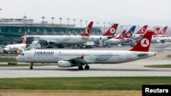 FILE - A Turkish Airlines plane prepares to take off at Ataturk International Airport in Istanbul, May 15, 2013.