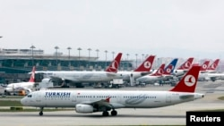 FILE - A Turkish Airlines plane prepares to take off at Ataturk International Airport in Istanbul, May 15, 2013. Turkey has deported some of eight Moroccans detained and questioned on arrival at Istanbul's main airport over suspected militant links, a Turkish government official said.