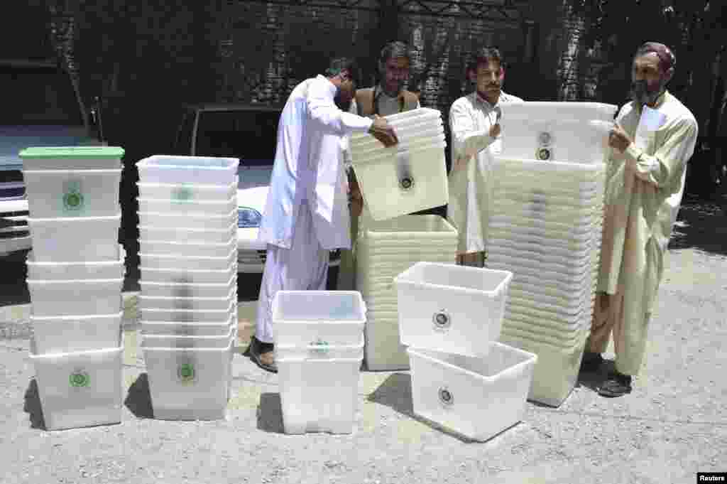 Election workers prepare ballot boxes at an election commission office in Quetta, Pakistan, May 8, 2013.