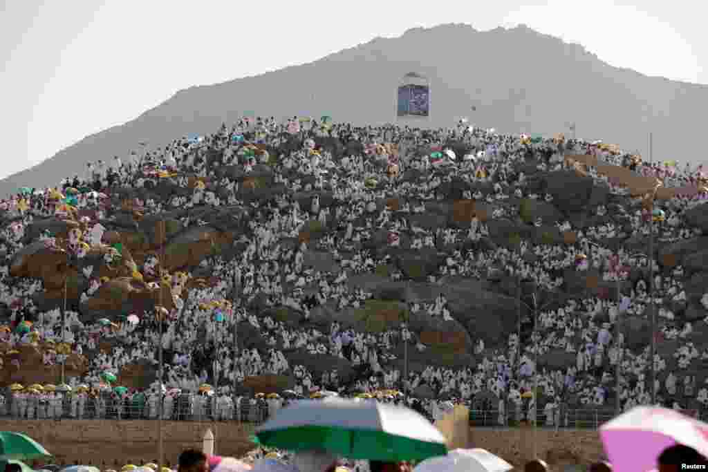 Muslim pilgrims gather on Mount Mercy on the plains of Arafat during the annual haj pilgrimage, outside the holy city of Mecca, Saudi Arabia.