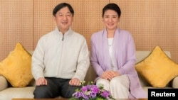 Japan's Crown Prince Naruhito and Crown Princess Masako pose for a photo at their residence, Togu Palace, in Tokyo, Feb. 17, 2019.