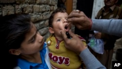 FILE - A Pakistani health worker gives a polio vaccine to a child in Islamabad, Dec. 8, 2014. (AP Photo/B.K. Bangash)