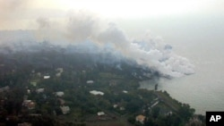 Lava hits the waters of Lake Kivu releasing gas and steam during an eruption of Nyiragongo volcano.