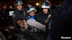 "New York Police Department (NYPD) officers arrest a young man during a protest against the killing of 16-year-old Kimani ""Kiki"" Gray who was killed in a shooting involving the NYPD, in the Brooklyn borough of New York Mar. 13, 2013."