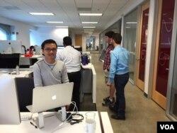 Software engineer Mok Sophal, 31, works at his desk at Target's online sales team office in Sunnyvale, CA, on September 1, 2016. (Sophat Soeung/VOA Khmer)