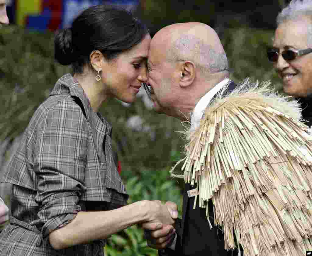 "Meghan, Duchess of Sussex receives a ""hongi"" a traditional Maori welcome on the lawns of Government House in Wellington, New Zealand."