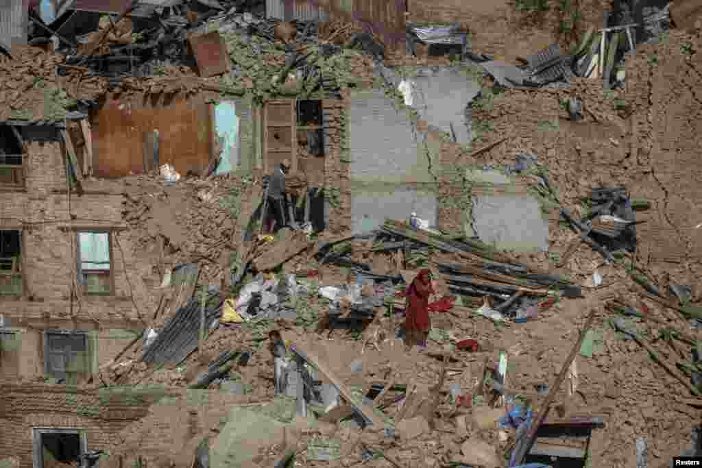Earthquake survivors search for their belongings from collapsed houses in Sankhu, on the outskirts of Kathmandu, Nepal.