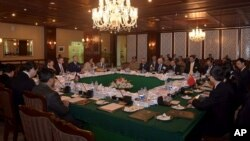 FILE - In this photo released by Associated Press of Pakistan, delegates from Pakistan, Afghanistan, China and United States attend a meeting hoping to lay the roadmap for peace talks with the Taliban, at the foreign ministry in Islamabad, Pakistan, Jan. 11, 2016.