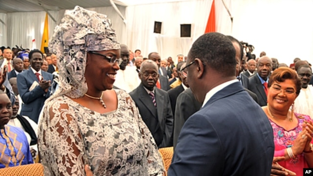 This handout photo shows Senegal's new president Macky Sall (R) greeting his wife Mareme Faye Sall, after the swearing-in ceremony Dakar on April 2, 2012.