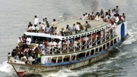 FILE - An overcrowded ferry plies the Buriganga river in Dhaka, Bangladesh, May 2002.