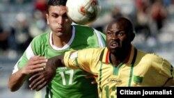 Former Warriors star striker, Adam Ndlovu (right)