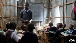 Children study at a private non-formal school, one of about 120 in the in Mathare slum, in Nairobi, Kenya, June 2, 2015. (Hilary Heuler / VOA)