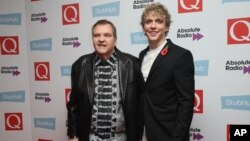 FILE - Meat Loaf (left) and Andrew Polec pose for photographers upon arrival for the Q Music Awards, at the Camden Roundhouse in London, Nov. 2, 2016.