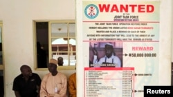 A wanted poster including a reward for the capture of Boko Haram leader Abubakar Shekau is posted on a wall in Baga village on the outskirts of Maiduguri, in the north-eastern state of Borno, Nigeria, May 13, 2013.