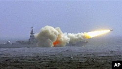 A destroyer of the South China Sea Fleet of the Chinese Navy fire a missile during a training in South China Sea, (File)