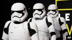 FILE - Actors dressed as Stormtroopers pose for photographers upon arrival at the European premiere of the film 'Star Wars: The Force Awakens ' in London, Dec. 16, 2015.