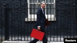 Britain's Chancellor of the Exchequer Phillip Hammond arrives in Downing Street in London, Britain, Sept. 7, 2016.