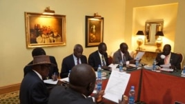 Negotiators at South Sudan peace talks in Addis Ababa review a draft cessation of hostilities agreement on Jan. 13, 2014.