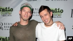 Josh Dun, left, and Tyler Joseph of the band Twenty One Pilots pose for photographers backstage during the Radio 104.5 9th Birthday Show at BB&T Pavilion, June 11, 2016, in Camden, N.J.