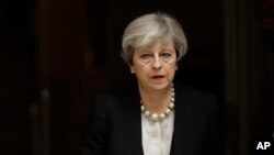 British Prime Minister Theresa May departs 10 Downing Street, London, to go to Manchester, May 23, 2017. The day after an apparent suicide bomber attacked an Ariana Grande concert as it ended Monday night, killing over a dozen of people among a panicked c