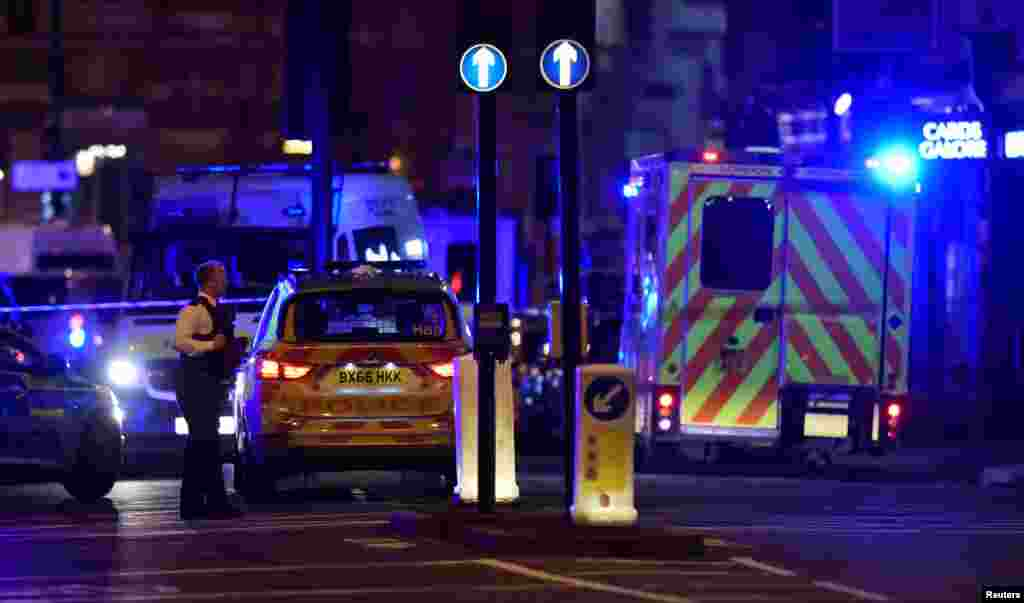Police say that late Saturday a vehicle mowed down pedestrians on London Bridge and men with large knives stabbing passersby at nearby Borough Market, June 3, 2017.