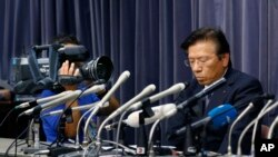 Mitsubishi President Tetsuro Aikawa listens to a reporter's question during a press conference in Tokyo, Wednesday, May 18, 2016.