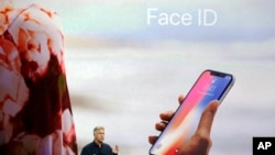 In this Tuesday, Sept. 12, 2017, file photo, Phil Schiller, Apple's senior vice president of worldwide marketing, announces features of the new iPhone X, including Face ID, at the new Apple campus in Cupertino, Calif. (AP Photo/Marcio Jose Sanchez, File)