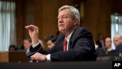 Retiring Montana Sen. Max Baucus testifies on Capitol Hill in Washington, Jan. 28, 2014, before the Senate Foreign Relations Committee hearing on his nomination to become U.S. ambassador to China.