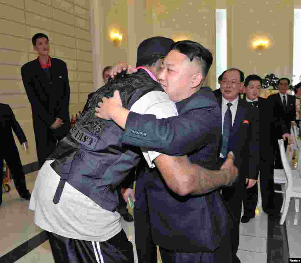 North Korean leader Kim Jong-Un and former NBA basketball player Dennis Rodman hug in Pyongyang in this undated picture released by North Korea's KCNA news agency.