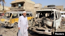 Hiện trường sau một vụ đánh bom xe ở quận Al-Mashtal trong thủ đô Baghdad.