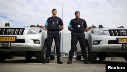 Border police from the Netherlands stand in front of their vehicles during the official launch of the European Union's Border and Coast Guard Agency at a border crossing on the Bulgarian-Turkish border in Kapitan Andreevo, Bulgaria, October 6, 2016.