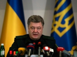 Ukrainian President Petro Poroshenko issues the order to start a cease-fire in the east during a meeting with defense officials in Kyiv, Feb. 15, 2015.