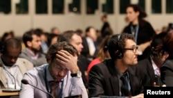 제19차 유엔 기후변화협약 폐막 회의에 각국 대표들이 참석했다.