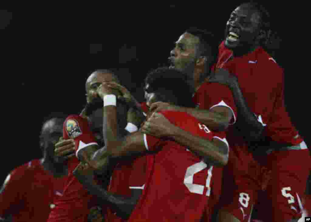 """Javier Balboa of Equatorial Guinea celebrates with his team after scoring against Libya during the opening match of the African Nations Cup soccer tournament in Estadio de Bata """"Bata Stadium"""", in Bata January 21, 2012."""