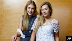 Maddie Marlow, left, and Tae Dye, of Maddie & Tae, pose for a portrait at Love Shack Studio in Nashville, Tennessee, Aug. 27, 2015.