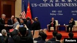 川普与习近平2017年11月出席美中商贸签约仪式(路透社)