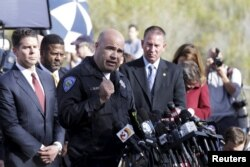 San Bernardino Police Department Chief Jarrod Burguan, center, speaks during a news conference in San Bernardino, Calif., Dec. 3, 2015.