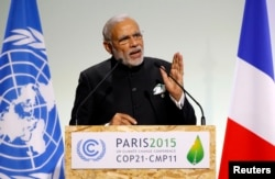 Indian Prime Minister Narendra Modi delivers a speech during the opening session of the World Climate Change Conference 2015 (COP21) at Le Bourget, near Paris, Nov. 30, 2015.