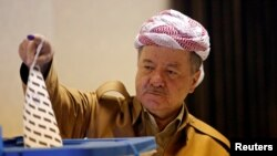 FILE - Former Iraqi Kurdistan region President Masoud Barzani casts his vote during parliamentary elections in the semiautonomous region, on the outskirts of Irbil, Iraq, Sept. 30, 2018.