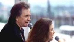 Country music legend Johnny Cash performs with his wife June Carter Cash, a member of the famous Carter Family.