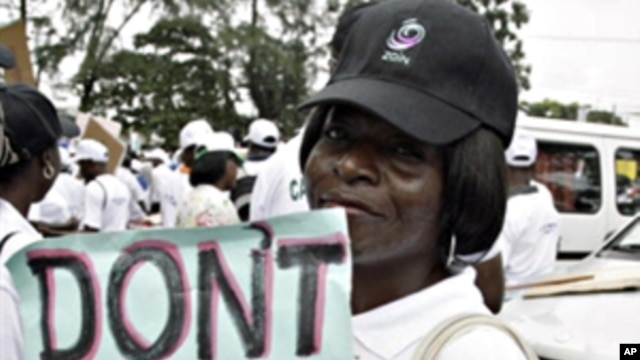 A lady carries placard at St. Leo Catholic church in Lagos, 09 Sept. 2010