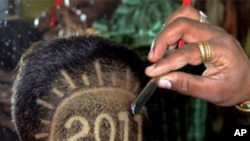 A man has his head shaved with the design to celebrate the new year in Karad, India, 31 Dec 2010.