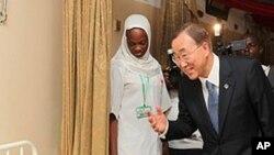 U.N. Secretary-General Ban Ki-moon talks to a patient in a hospital in Abuja, Nigeria.