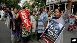FILE - Activists of Socialist Unity Center of India-Marxist (SUCI-M) protest a recent case of child trafficking in West Bengal state in Kolkata, India, Nov. 29, 2016. Officials busted a child trafficking racket and rescued more than 20 children, according to news reports.