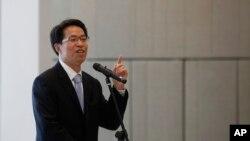 FILE - Beijing's top representative in Hong Kong, Zhang Xiaoming, in Hong Kong, July 16, 2013.