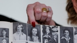 Accuser Beverly Young Nelson points to a photograph of herself in her high school yearbook after making a statement claiming that Alabama senate candidate Roy Moore sexually harassed her when she was 16, in New York, Nov. 13, 2017.