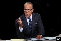 "FILE - Moderator Lester Holt, anchor of ""NBC Nightly News,"" asks a question during the presidential debate at Hofstra University in Hempstead, N.Y., Sept. 26, 2016. Holt says his trip to North Korea was valuable despite restrictions placed upon him by his hosts."