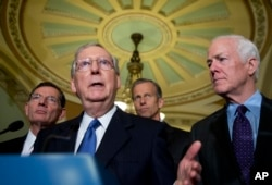 FILE - Senate Majority Leader Mitch McConnell of Ky., with, from left, Sens. John Barrasso, R-Wy., John Thune, R-S.D., and Senate Majority Whip John Cornyn, R-Texas, speaks to reporters on Capitol Hill in Washington, May 10, 2016.