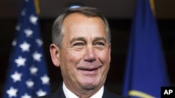 House Speaker John Boehner of Ohio smiles during a news conference on Capitol Hill in Washington, Nov. 6, 2014.